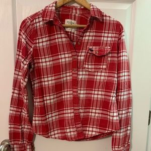 Plaid red and white button up shirt. Size Medium
